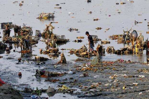 A polluted Yamuna after immersion of Ganesh idols after Ganesh Chaturthi, at Yamuna river in New Delhi in September last year. Apart from the celebrations, the tradition of immersing clay idols in water bodies causes a lot of water pollution. HT